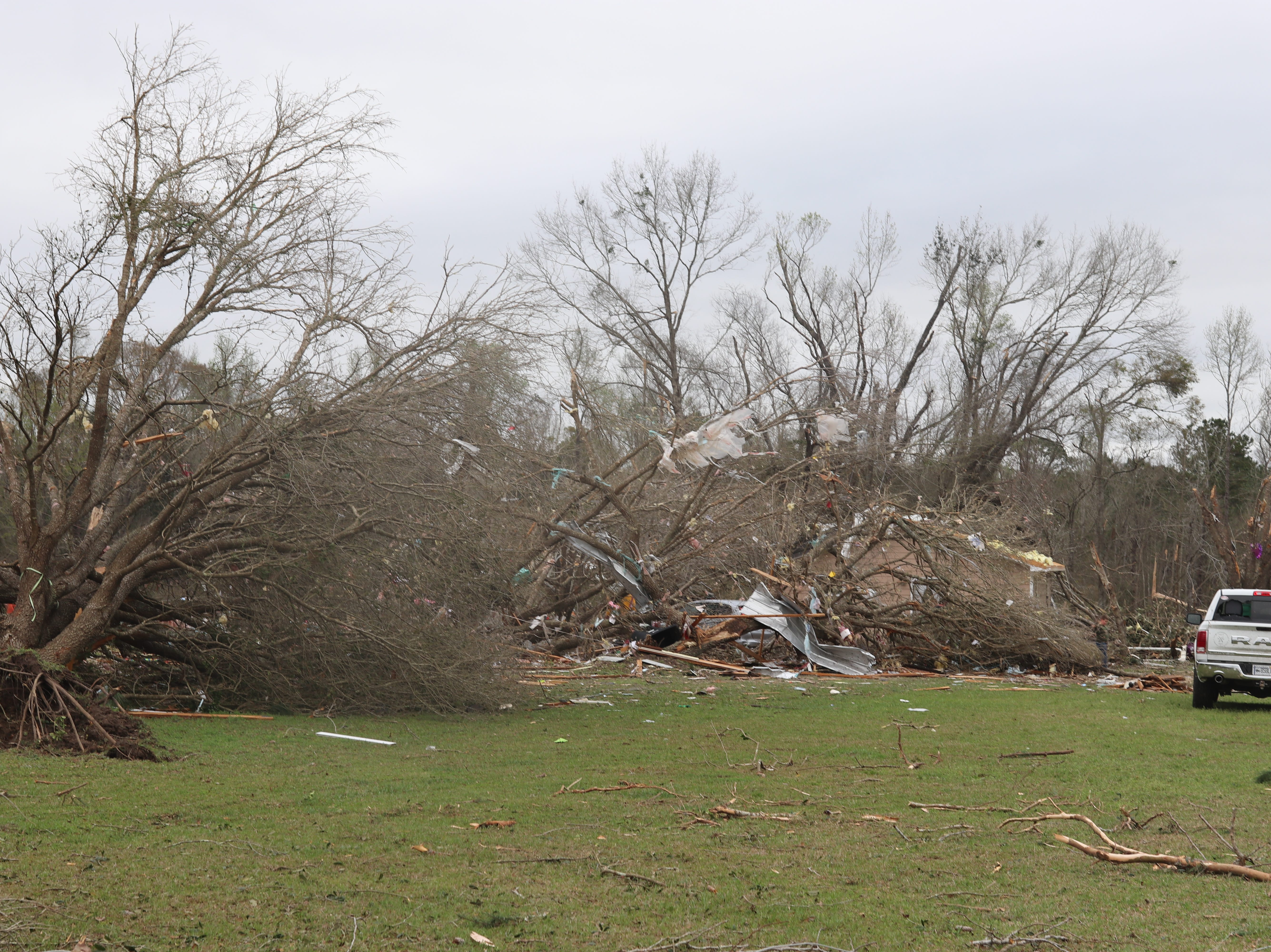 Debris scattered across the yard of David and Kathy Byler in the Baum Community after a tornado touched down Sunday March 3.