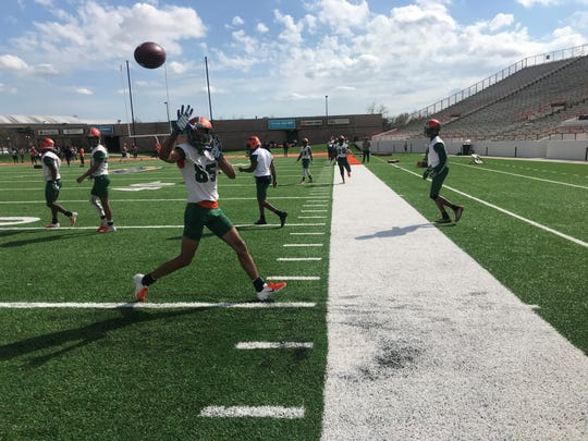 FAMU wide receiver David Manigo makes a sideline catch during the first day of spring camp on Sunday, March 3, 2019.