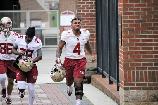FSU running back Khalan Laborn runs out to the first spring practice of 2019.