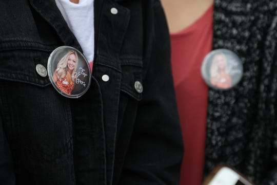 Friends and family members wore pins in remembrance of Maura Binkley at a gathering to celebrate the launch of a foundation created in her honor to research and understand the relationship between mental illness, hate and violence at the Florida Historic Capitol Monday, March 4, 2018.