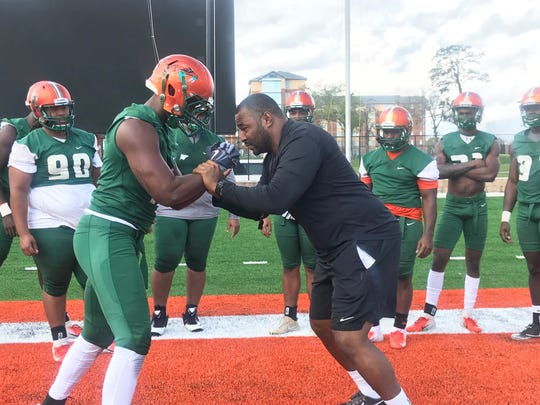 FAMU defensive coordinator Ralph Street (right) teaches linebacker Jelani Bland balance and strength during spring practice on Sunday, March 3, 2019.