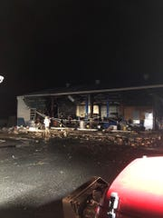 A tornado damaged buildings in Cairo, Georgia, Sunday night. This photo, taken by Eli Pyrz of Center Drugs, shows the scene next door.