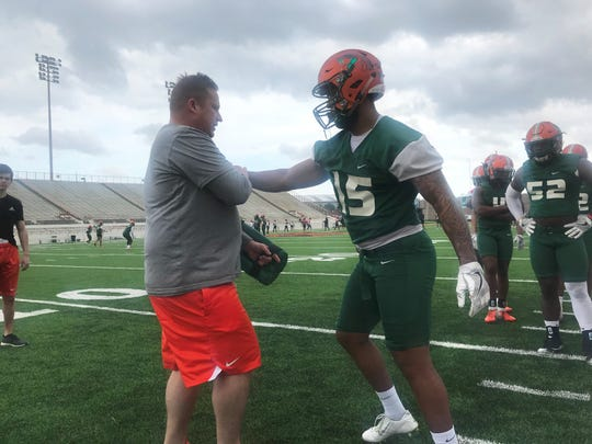FAMU linebackers coach Ryan Smith works with Elijah Richardson during the first day of spring practice on Sunday, March 3, 2019.