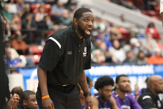 Crossroad Academy coach AnDonte Gennie yells instructions as the Scorpions fell 59-44 to Central Florida Christian during a Class 2A state semifinal at the RP Funding Center in Lakeland on March 4, 2019.