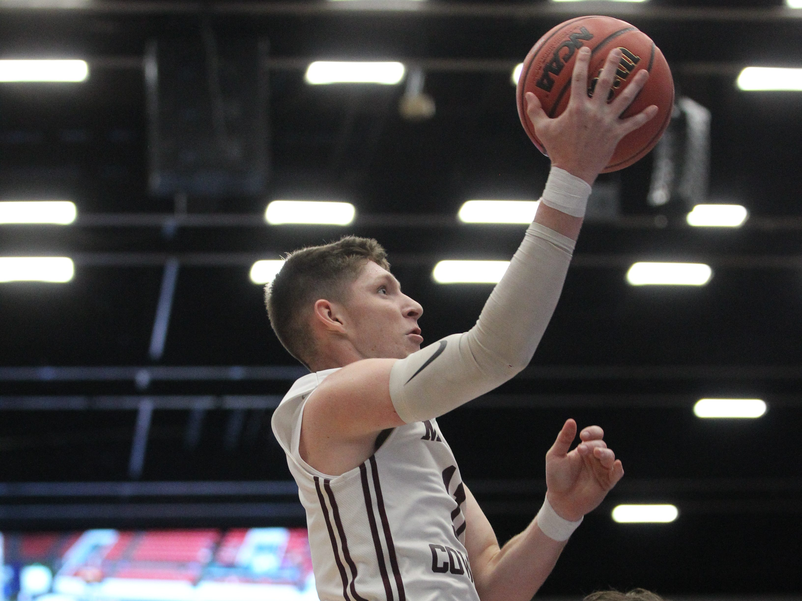 Madison County senior forward Dilan Lawson goes up for a layup and gets fouled as the Cowboys beat Paxton 63-51 during a Class 1A state semifinal at the RP Funding Center in Lakeland on March 4, 2019.