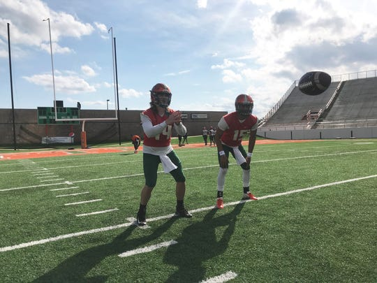 FAMU quarterback Ryan Stanley (left) gets set to take a snap alongside D.J. Phillips during the first day of spring practice on Sunday, March 3, 2019.