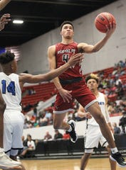 Franklin County senior Simon Brathwaite goes up for a layup as the Seahawks lost 76-62 to Wildwood during a Class 1A state semifinal at the RP Funding Center in Lakeland on March 4, 2019.
