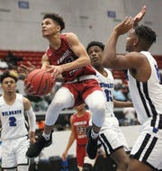 Franklin County sophomore Lamarius Martin scoops a layup as the Seahawks lost 76-60 to Wildwood during a Class 1A state semifinal at the RP Funding Center in Lakeland on March 4, 2019.