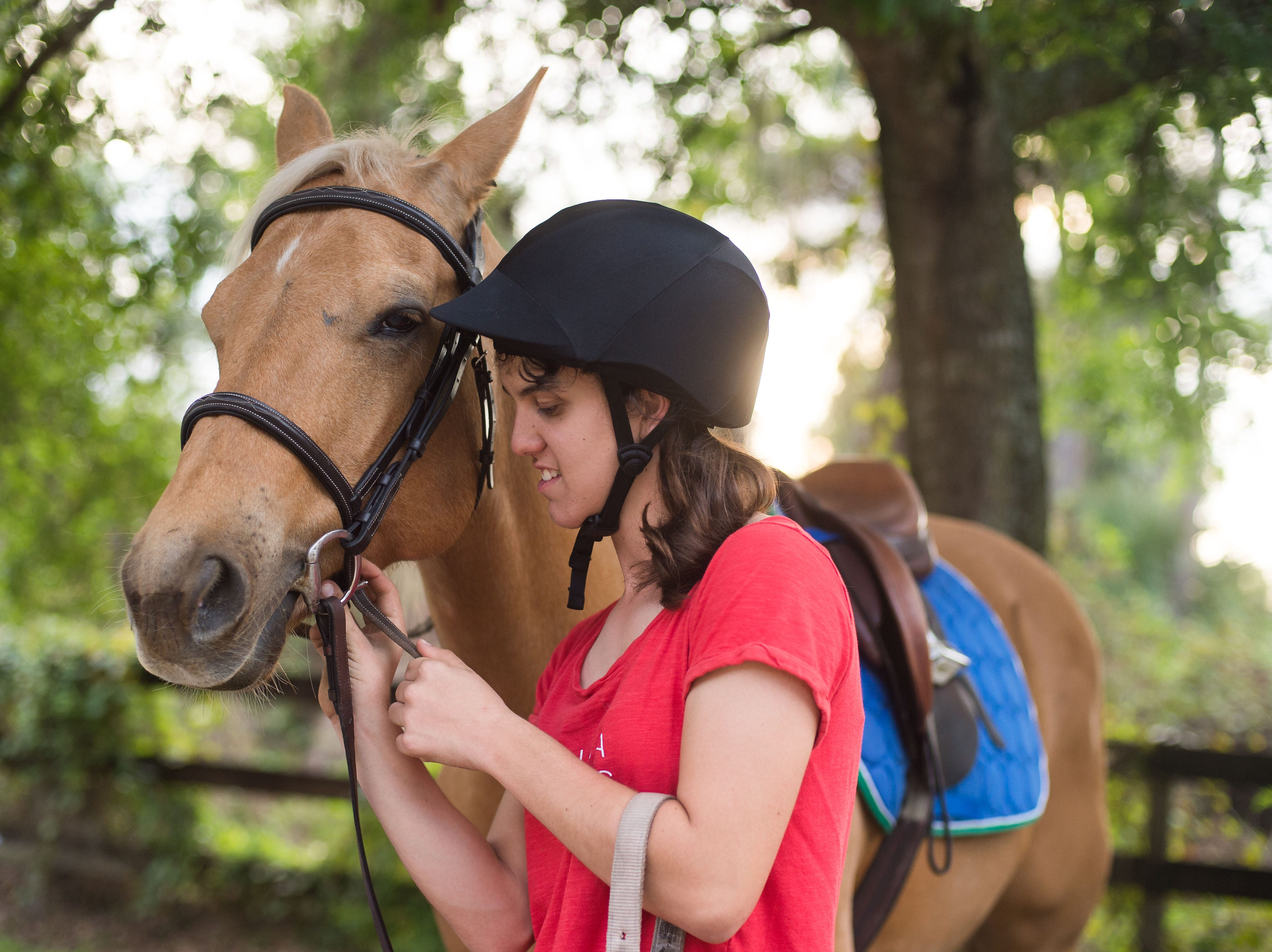 Equestrian Cori Davis, of Palm City, works with riding instructor Patty Nelson, of Stuart, and Jaye, one of her family's horses, at Davis' home March 1, 2019, in Palm City. Davis will be traveling to Abu Dhabi, United Arab Emirates, to compete in the 2019 Special Olympics World Games, which begin March 14.