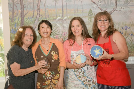 Leona Zegar, left, May Wong, Karen Moore and Sharon Garton at the 13th annual Lundin Kudo Empty Bowls Project at the Woman's Club of Stuart.