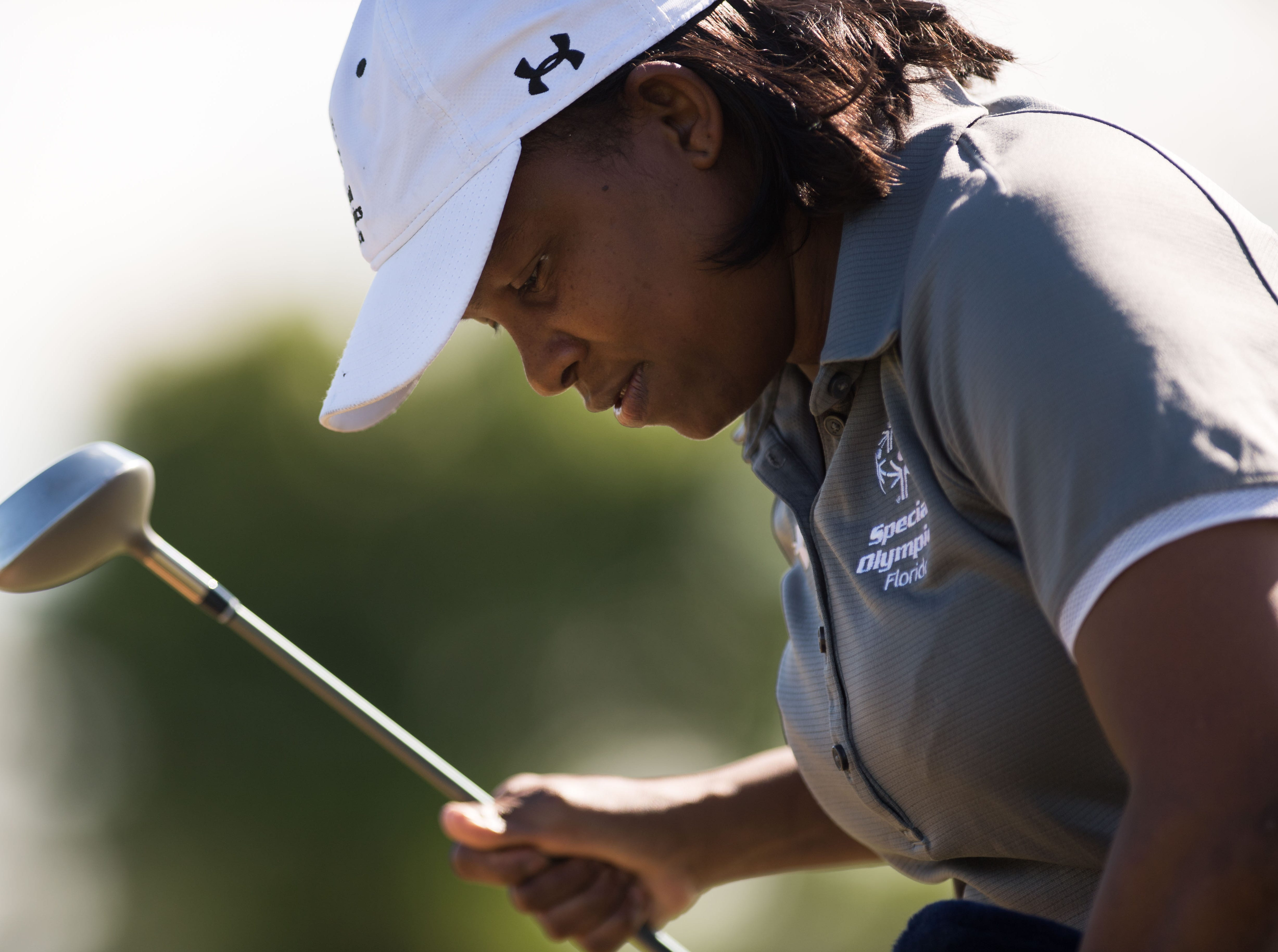 Kenyatta Johnson, of Fort Pierce, practices her driving and putting at Fairwinds Golf Course on Feb. 28, 2019, in Fort Pierce. Johnson will be traveling to Abu Dhabi, United Arab Emirates, to compete in the 2019 Special Olympics World Games, which begin March 14.