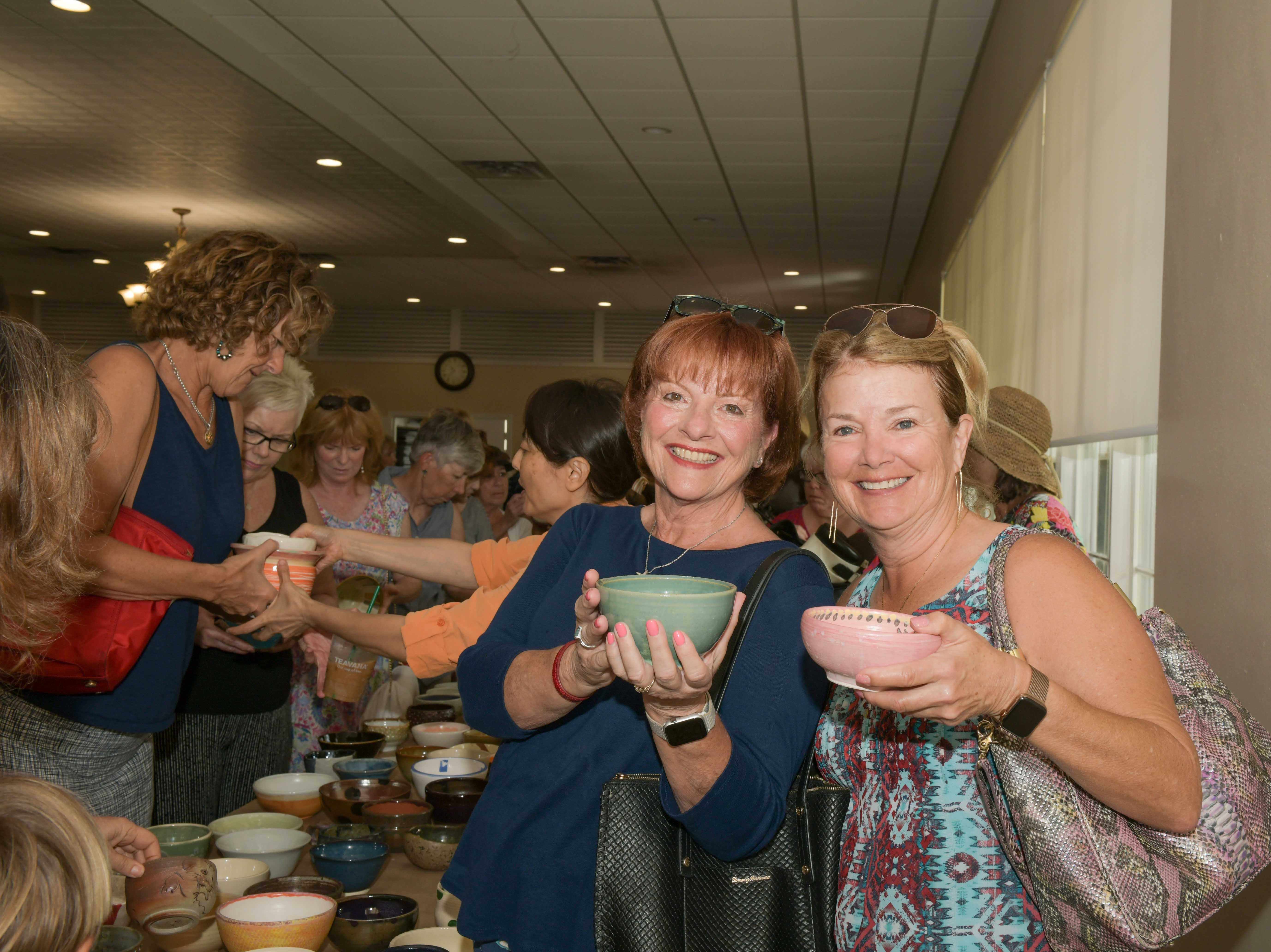 Pat Hoar, left, and Carol Myers at the 13th annual Lundin Kudo Empty Bowls Project at the Woman's Club of Stuart.