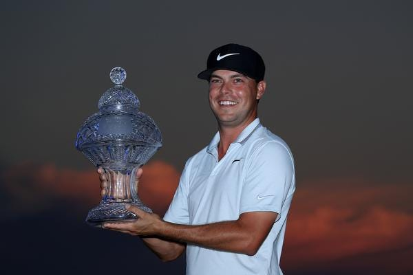 Keith Mitchell poses with the trophy after winning the Honda Classic at PGA National Resort and Spa on March 03, 2019 in Palm Beach Gardens.