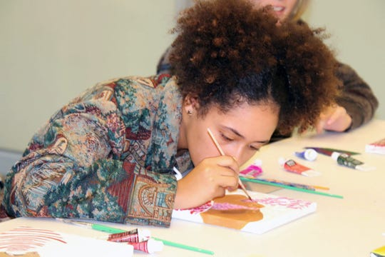 Mya DeSimone focuses on creating movement with medium in a kinetic pointillism exercise.
