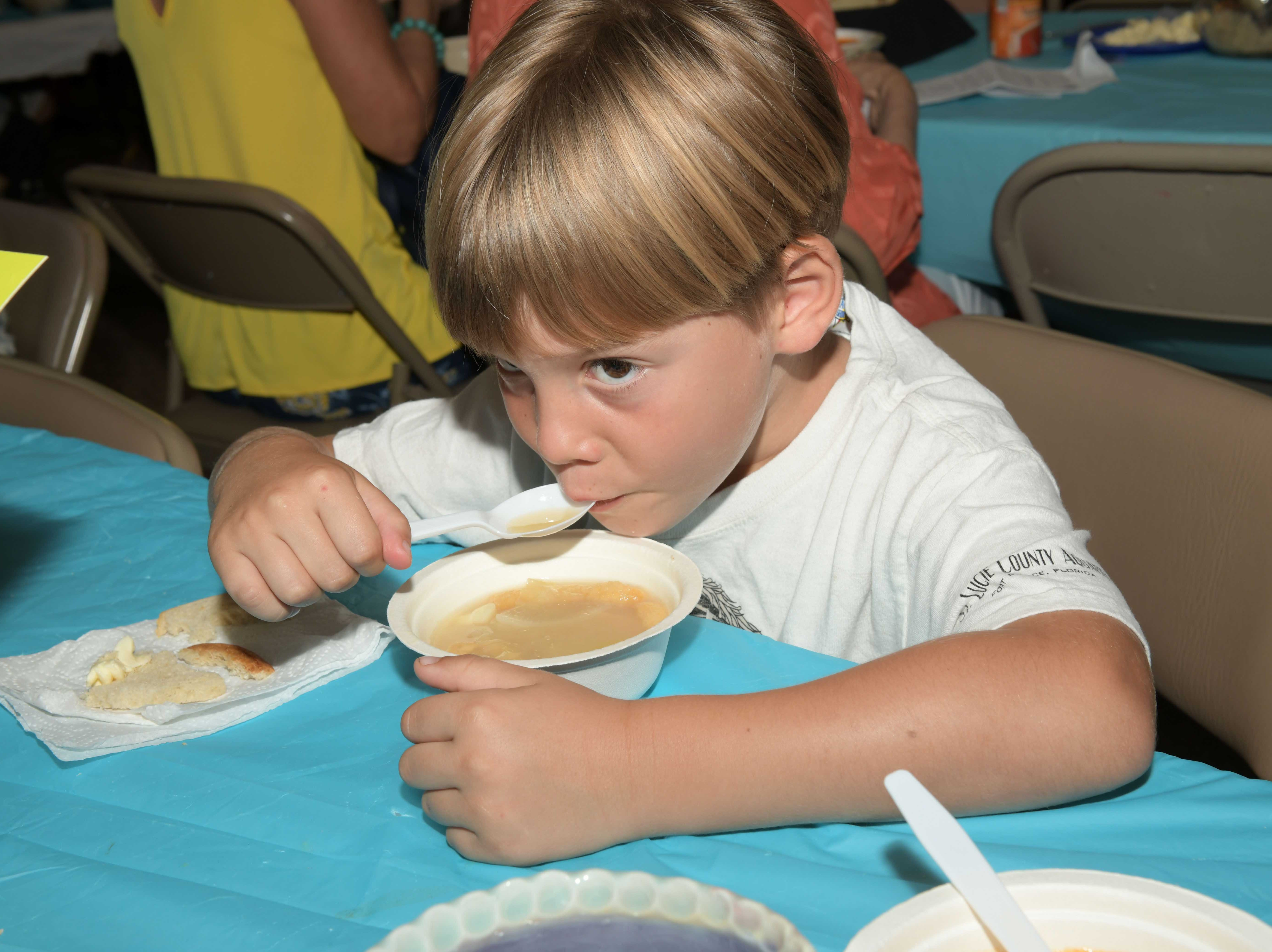 Walter MacKinnon enjoys a bowl of hot soup at the 13th annual Lundin Kudo Empty Bowls Project at the Woman's Club of Stuart.