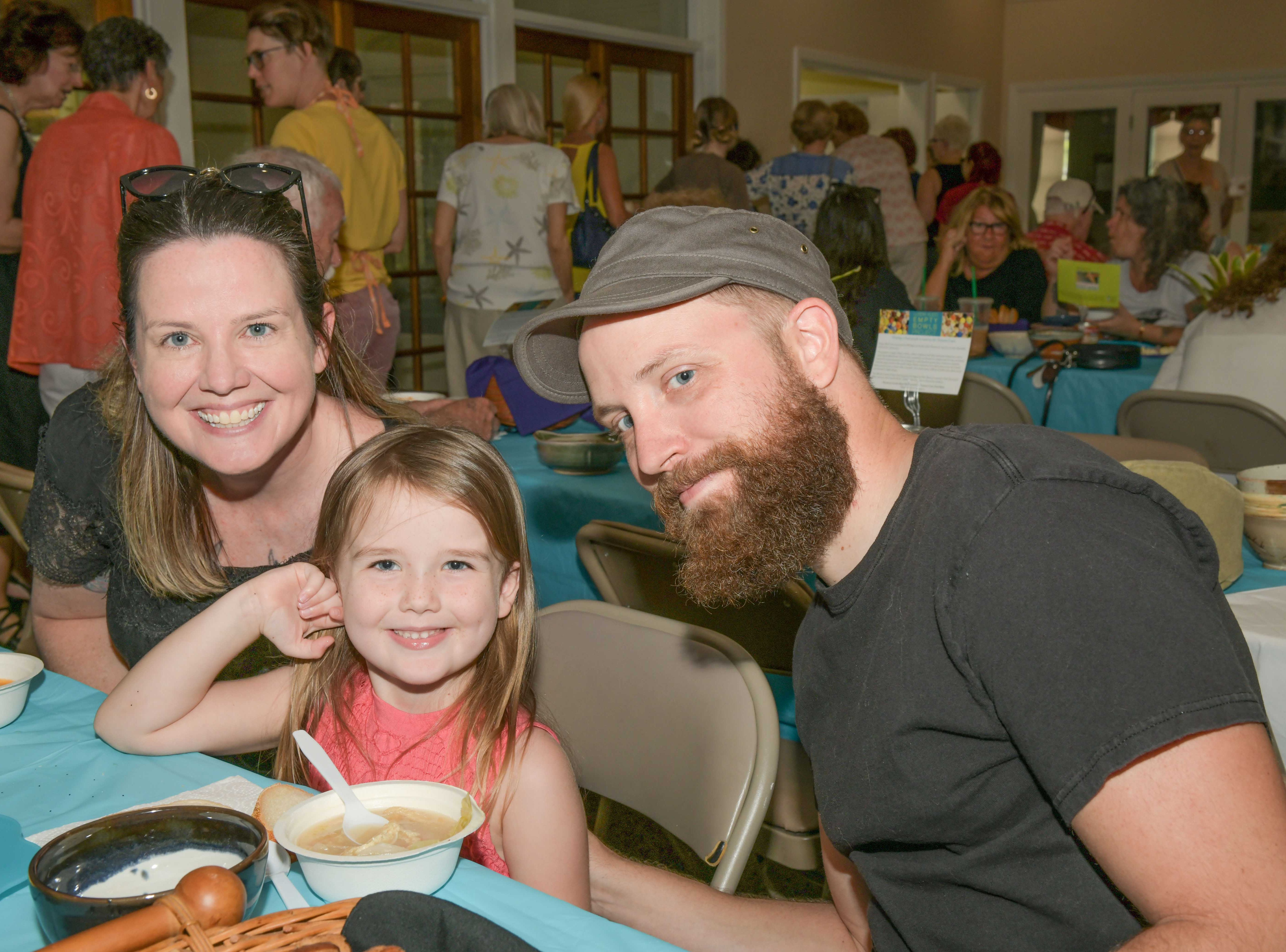 Empty Bowls is a family affair for Rachel, left, Cardyn and Chris Colvin at the 13th annual Lundin Kudo Empty Bowls Project at the Woman's Club of Stuart.