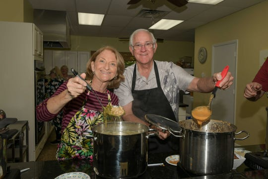 Karen Hester, left, serving white bean and escarole and Craig Rich with lobster bisque at the 13th annual Lundin Kudo Empty Bowls Project at the Woman's Club of Stuart.