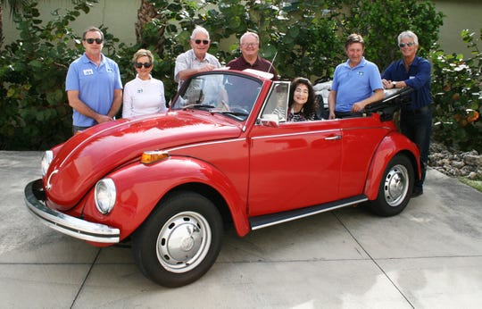 "2019 Classics at the Beach Car Show Committee, from left, Associate Car Curator John Giltinan, Special Events Coordinator Debbie Banta, Elliott Museum board member Joe Vicini, sponsor Mike Searle, Car Show Committee Chair Rachelle ""Rocky"" Grady, Associate Car Curator Don Gilbert and Elliott Museum President/CEO Rob Steele."