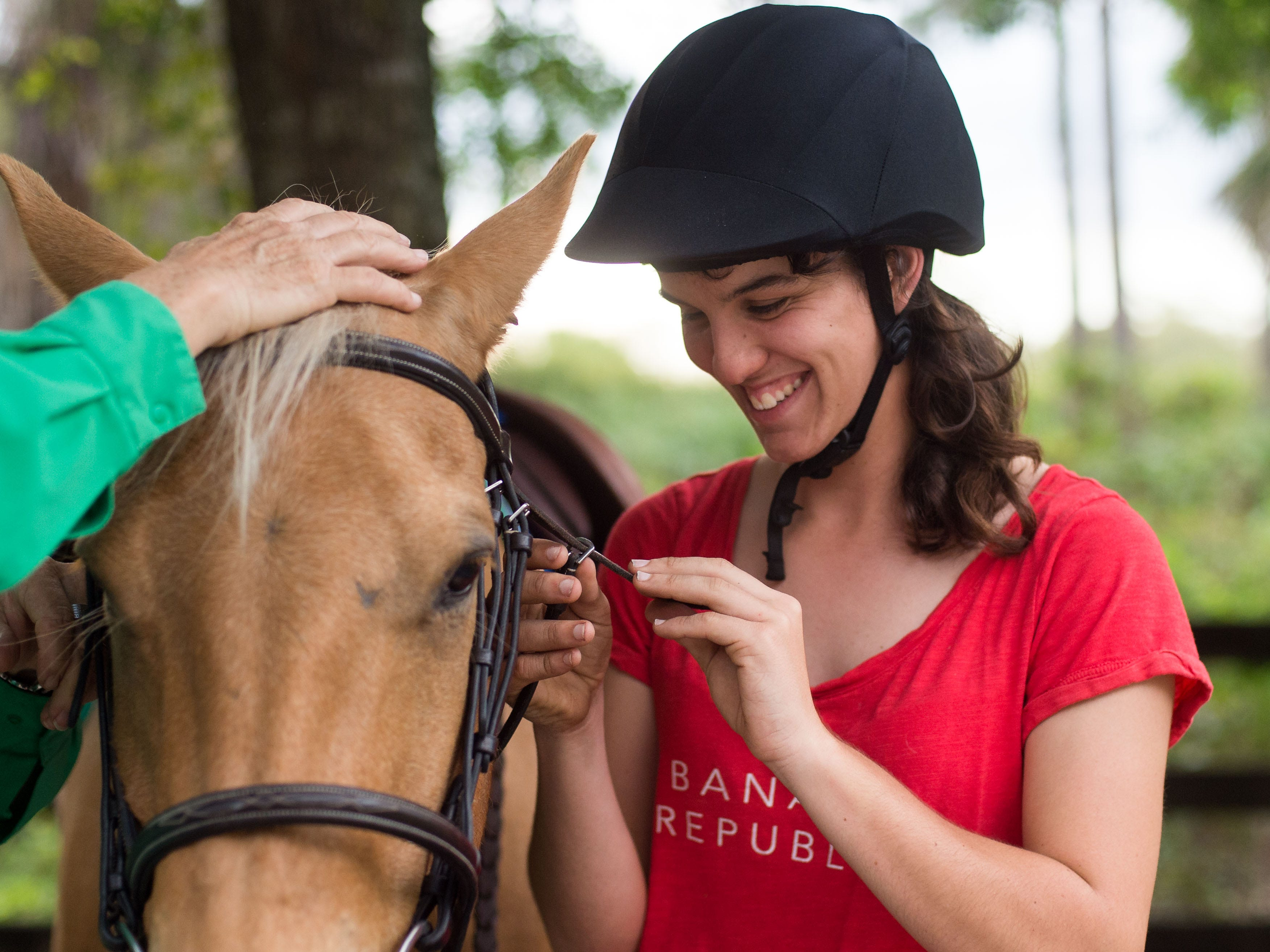 Equestrian Cori Davis, of Palm City, prepares Jaye, one of her family's horses, with help from riding instructor Patty Nelson at Davis' home March 1, 2019, in Palm City. Davis will be traveling to Abu Dhabi, United Arab Emirates, to compete in the 2019 Special Olympics World Games, which begin March 14.