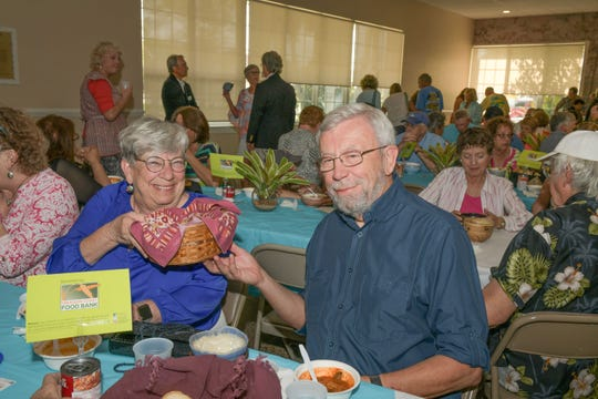 Carol and David Seidel at the 13th annual Lundin Kudo Empty Bowls Project at the Woman's Club of Stuart.
