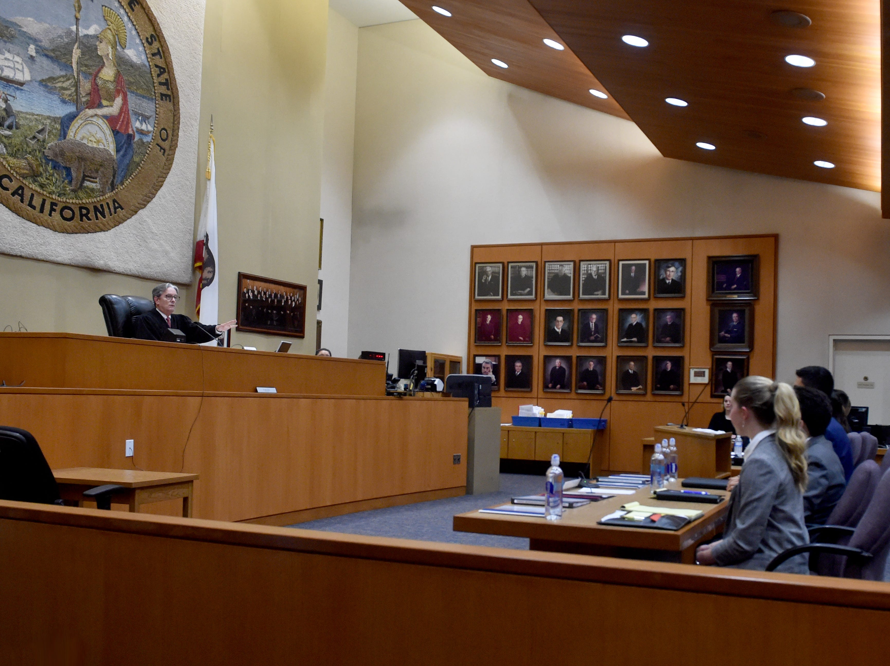 Judge Kent Kellegrew speaks with teams from Trinity Pacific Christian School in Thousand Oaks and St. Bonaventure High School in Ventura during the final round of the Ventura County Mock Trial on Thursday at the Ventura County Superior Court.