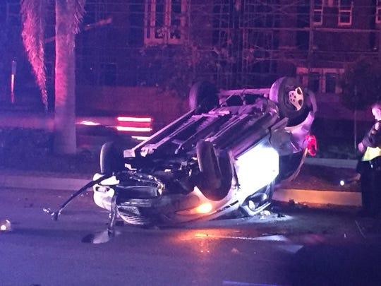 An overturned car on Ventura Road in Oxnard Sunday night after a single-vehicle crash. The 23-year-old female driver was arrested on suspicion of driving under the influence of alcohol, officials said.