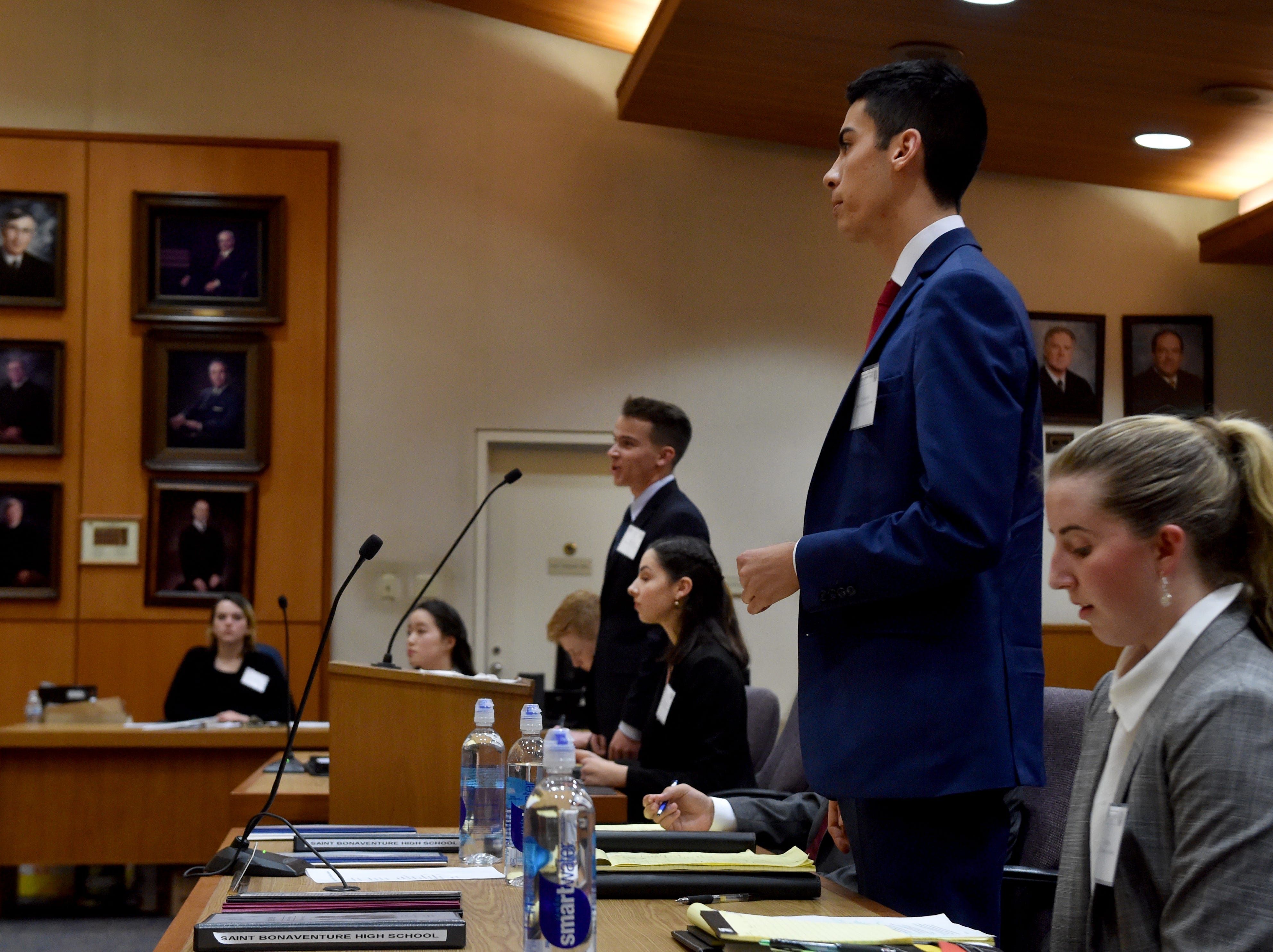 Micheal Paz, of St. Bonaventure High in Ventura, and Morgan Nash, of Trinity Pacific Christian School in Thousand Oaks, stand for the judge during the final rounds of the Ventura County Mock Trial on Thursday.