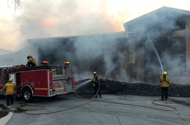 Flames burned near the Las Virgenes Municipal Water District's Calabasas headquarters during the Woolsey Fire.