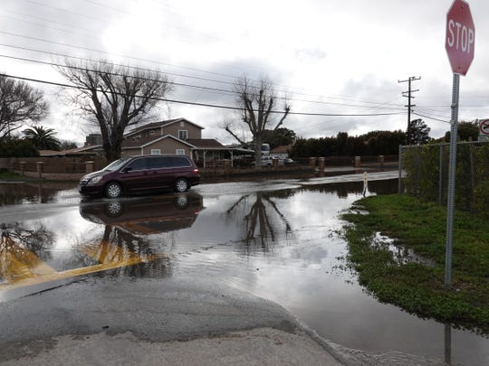 The intersection of Balboa and Stroube streets in El Rio remained flooded late Sunday afternoon after a storm system passed through Ventura County Saturday night.