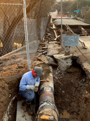 Las Virgenes Municipal crews patched up the water main that broke after a bridge burned in the Woolsey Fire.