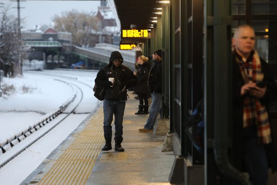 Commuters brave the cold and snow at the Tarrytown train station on Monday, March 4, 2019.