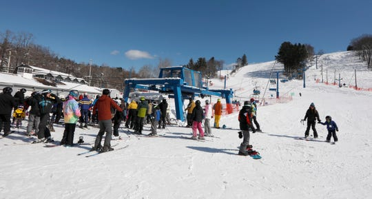 Skiers and snowboarders line up for the chair lift to the top of the mountain at Thunder Ridge Ski Area in Patterson March 4, 2019. An overnight snow storm added seven to eight inches of snow at Thunder Ridge, according to Meryl Dido, Thunder Ridge's office manager. With children getting the day off from school due to the storm, the slopes were crowded with both adults and children.
