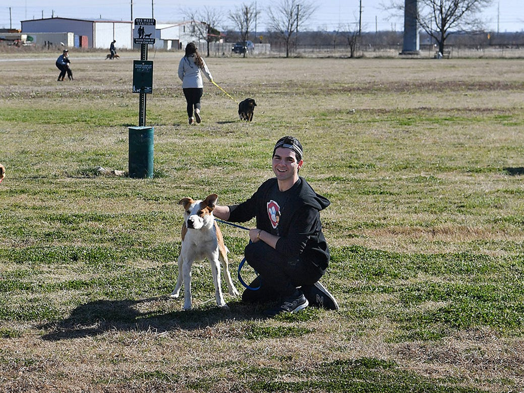Tony Ardolino, who plays Ryder in Paw Patrol Live, plays with Bo Monday afternoon at the Humane Society of Wichita County.
