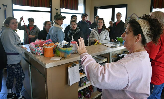 In this file photo, Cheryl Miller, executive director of the Humane Society of Wichita County, gives directions to cast and crew members of the show Paw Patrol, as they arrive to volunteer.