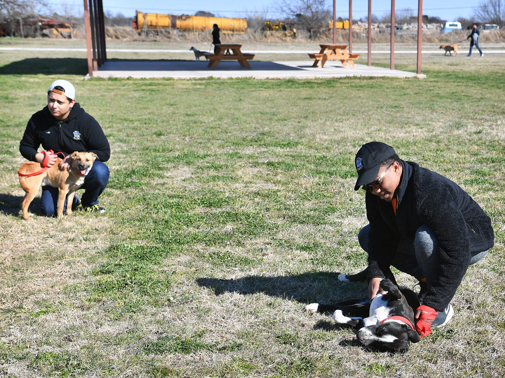 Alex Garcia, left, and Brett Jones joined other cast members of the Paw Patrol Live show in volunteering at the Humane Society of Wichita County Monday afternoon.