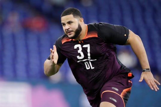 Texas A&M offensive lineman Erik McCoy runs a drill at the NFL football scouting combine in Indianapolis, Friday, March 1, 2019. (AP Photo/Michael Conroy)