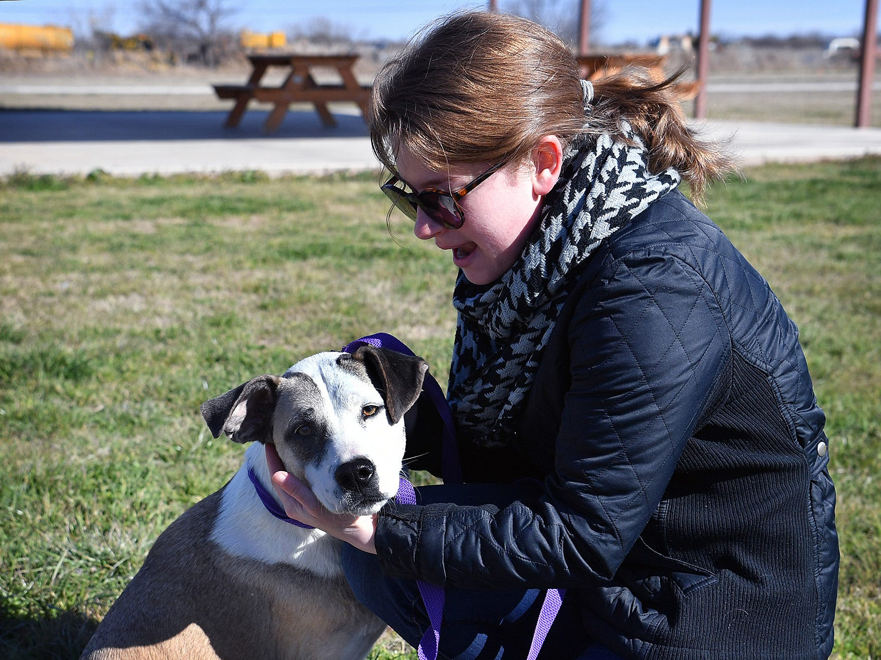 """""""Puddles"""" gets some attention from Maddie Drees, aka Skye, as she and other members of Paw Patrol Live volunteered at the Humane Society of Wichita County Monday afternoon."""