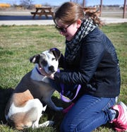 """Puddles"" gets some attention from Maddie Drees, aka Skye, as she and other members of Paw Patrol Live volunteered at the Humane Society of Wichita County Monday afternoon."