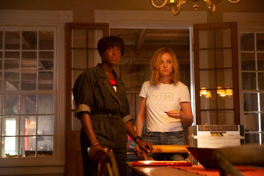 "Maria Rambeau (Lashana Lynch, left) reconnects with old friend Carol Danvers (Brie Larson) in ""Captain Marvel."""