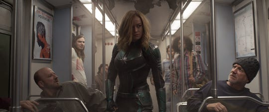 "Carol Danvers (Brie Larson, center) searches for hidden alien Skrulls in ""Captain Marvel."""