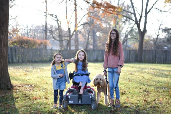 Writer Amy Webb's three daughters. In honor of Developmental Disability Awareness Month, Webb is asking parents to have their kids stay and play - rather than leave - when they meet a child with special needs.