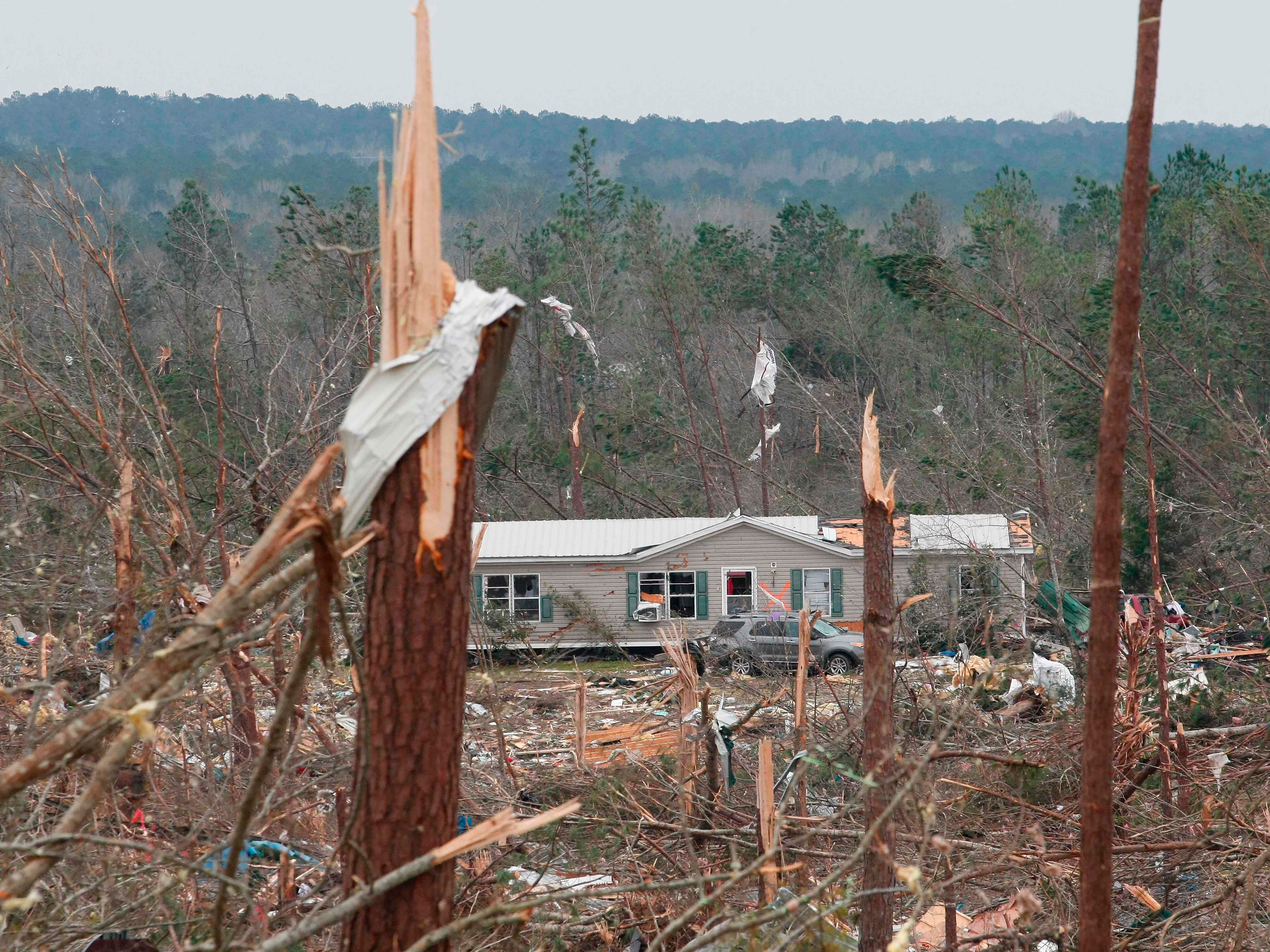 """Damage is seen from a tornado which killed at least 23 people in Beauregard, Alabama on March 4, 2019. Rescuers in Alabama were set to resume search operations Monday after at least two tornadoes killed 23 people, uprooted trees and caused """"catastrophic"""" damage to buildings and roads in the southern US state.""""The devastation is incredible,"""" Lee County Sheriff Jay Jones told the local CBS affiliate late Sunday.""""I cannot recall at least in the last 50 years... a situation where we have had this loss of life that we experienced today."""""""