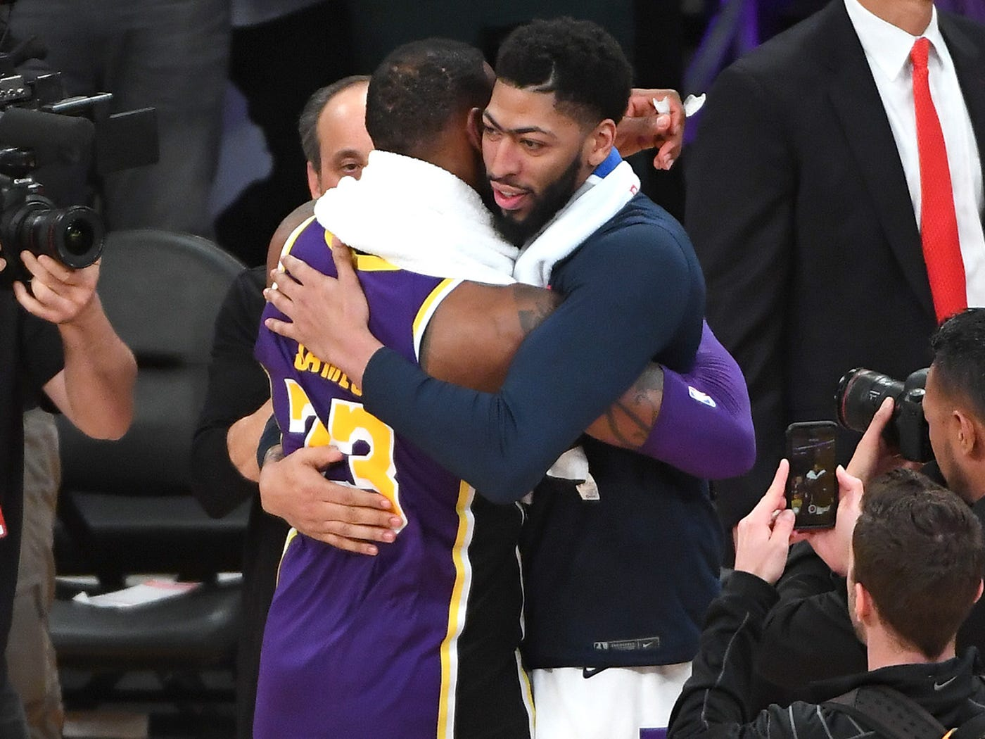 Feb. 27, 2019: James shares a hug with Pelicans star Anthony Davis after a game in Los Angeles.