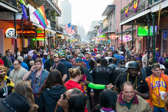 Beads and crowds on Bourbon Street during Mardi Gras in New Orleans, Louisiana.