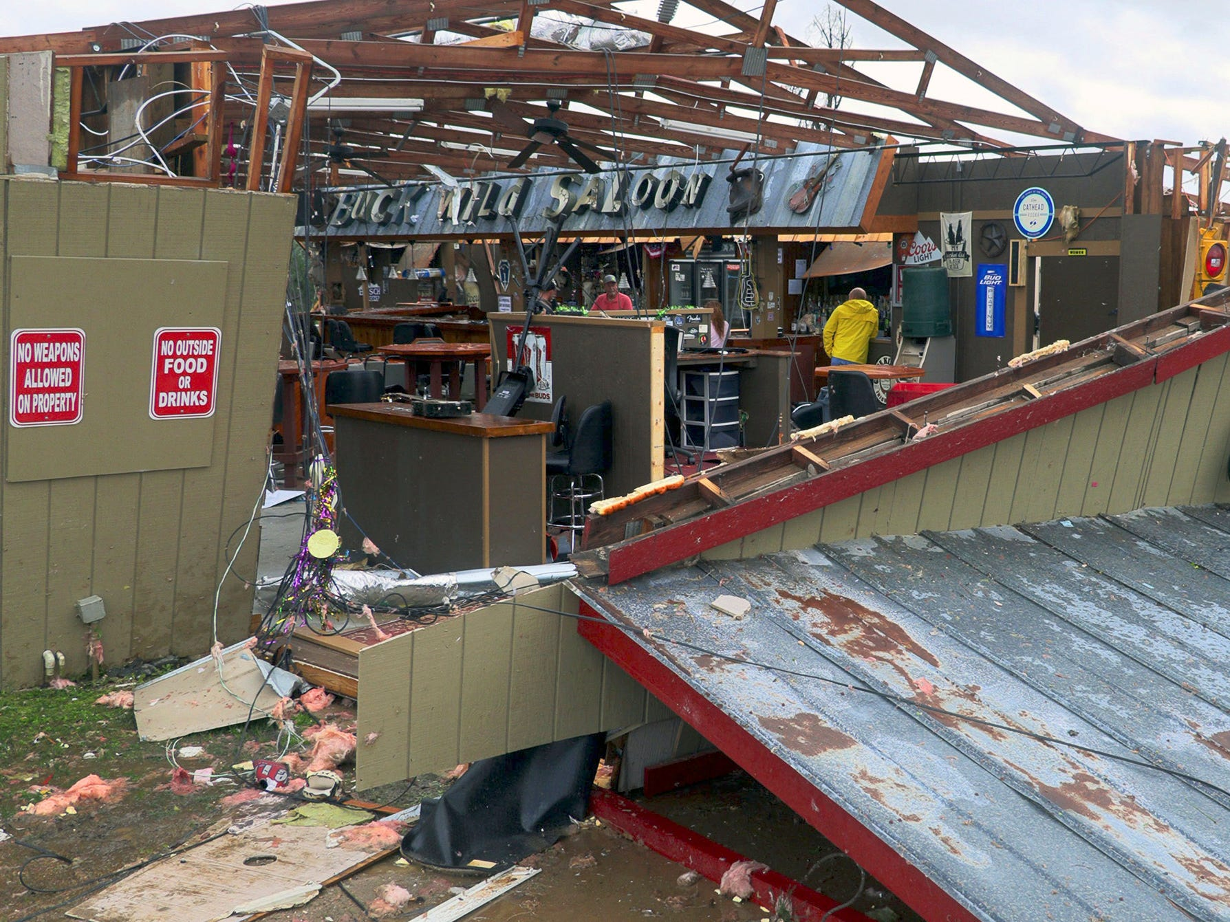 In this Sunday, March 3, 2019 photo, debris litters the Buck Wild Saloon, after it was heavily damaged by a tornado, in Smiths Station, Ala. (Mike Haskey/Ledger-Enquirer via AP) ORG XMIT: GACOL601