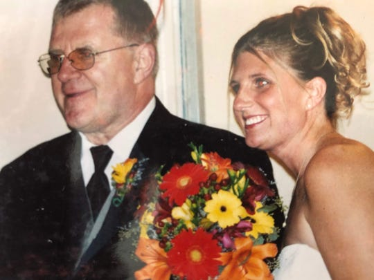 Kimberly McDonald of Richmond, Wisc. is shown with her father Gerry Middag on her wedding day in 2003. Middag died by suicide in 2010 while suffering from Parkinson's disease and after he was also diagnosed with Lewy body dementia.