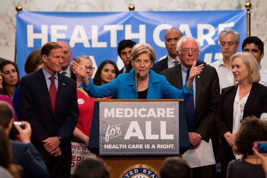 Senator Elizabeth Warren, Senator Bernie Sanders and New York Senator Kirsten Gillibrand in Washington, D.C. on Sept. 13, 2017.