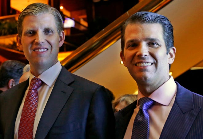 Eric Trump, left, and Donald Trump Jr., executive vice presidents of The Trump Organization, pose for a photograph in New York on June 5, 2017.