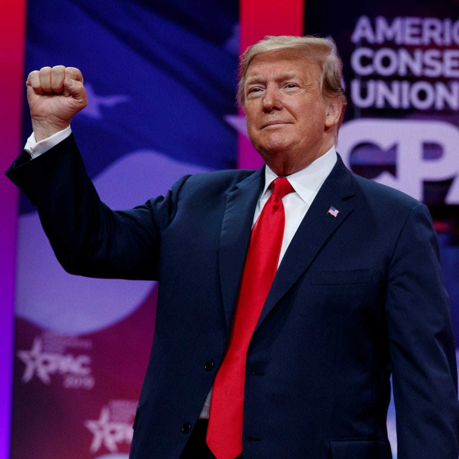 President Donald Trump gestures to the cheering audience as he arrives to speak at Conservative Political Action Conference, CPAC 2019, in Oxon Hill, Maryland, March 2, 2019.