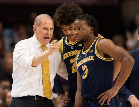 Michigan coach John Beilein speaks with Jordan Poole (2) and Zavier Simpson during the team's game against Maryland in 2019.
